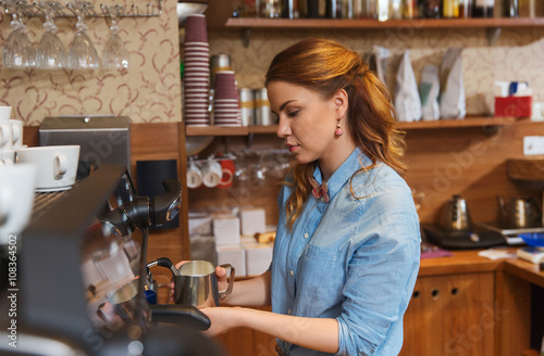 Fotografie, Obraz  barista woman making coffee by machine at cafe