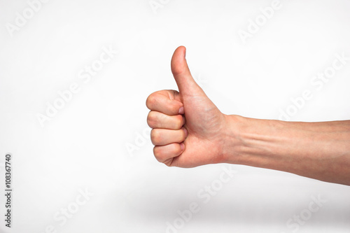 Fotografie, Obraz  male hand showing thumbs up sign