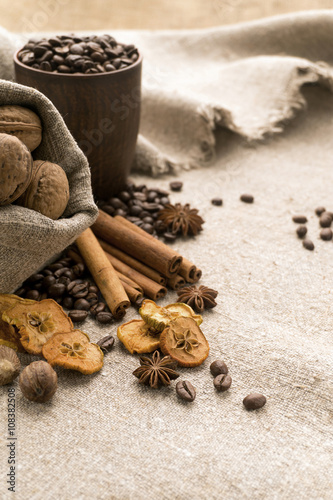 Coffee beans, cinnamon, star anise, walnuts, nutmeg, dried fruit