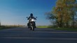 Biker on the road - the extreme lower point shooting