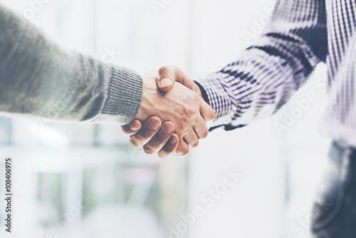Obraz Business partnership meeting concept. Image businessmans handshake. Successful businessmen handshaking after good deal. Horizontal, blurred background - fototapety do salonu