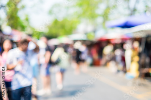 Fotografia  Blurred background : people shopping at market fair in sunny day