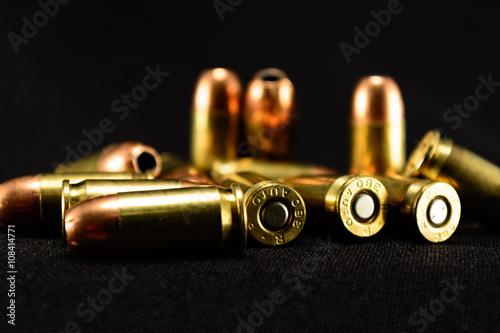 Fotografia  Bullets on Black Background, selective focus foreground