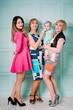 Happy family of women, three generations . Fashion style studio portrait.