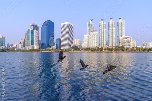Bangkok skyline and water reflection with urban lake in summer. Wallpaper Mural