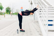 Woman doing exercises in the city