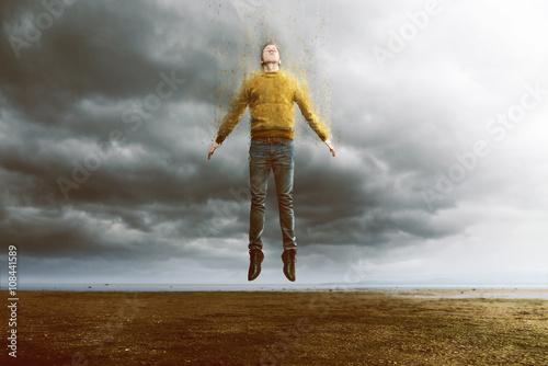 Fotografie, Obraz  Mann schwebt und sich auf ke ztrátě