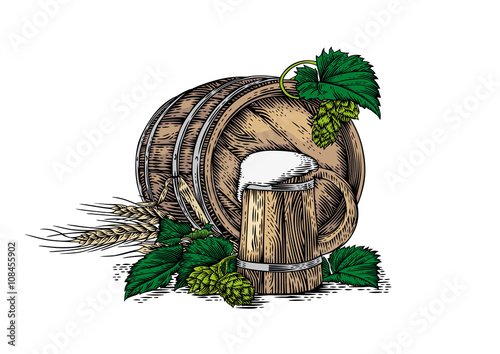 Foto  Wooden beer mug, wooden barrel, barley and hop