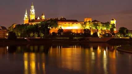 Panel SzklanyWawel Hill above Vistula River in Krakow at night