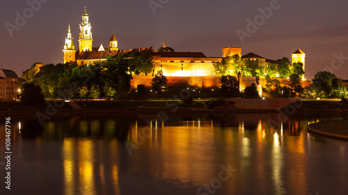 Wawel Hill above Vistula River in Krakow at night - 108467796