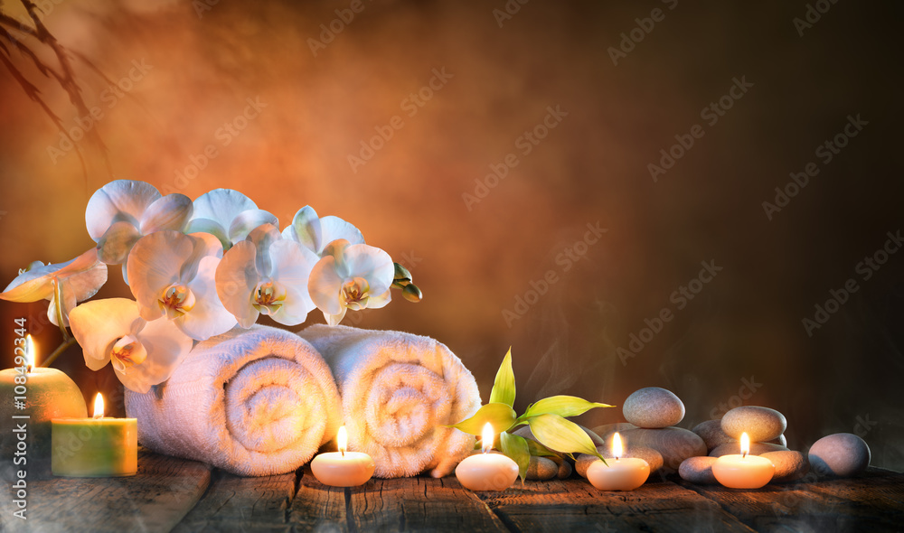 Fototapeta Spa - Couple Towels With Candles And Orchid For Natural Massage