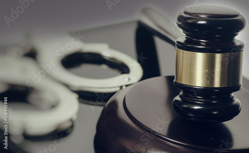 Valokuva Legal law concept image - gavel and handcuffs