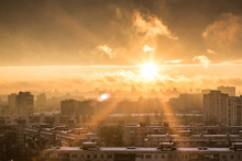 Orange Sunset Over The City