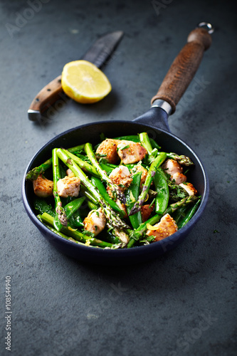 Photo  Sesame Seed Chicken with Green Asparagus and Sweet Peas