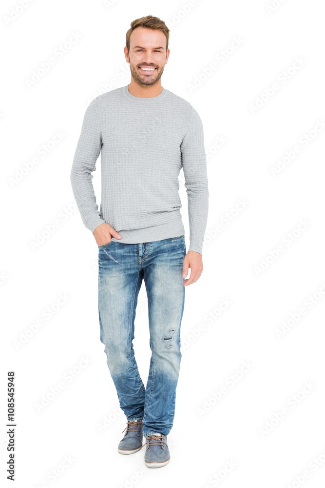 Fototapeta Young man standing with hands in pocket