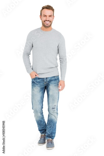 Fototapeta Young man standing with hands in pocket obraz
