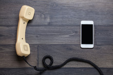 Old Retro Phone And New Cell P...