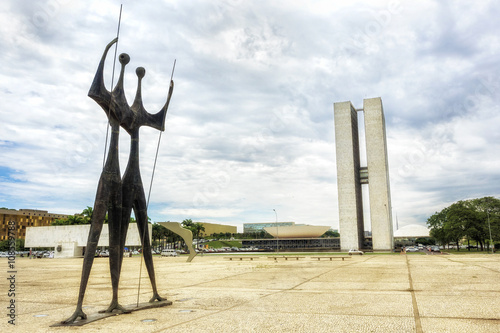 Brazilian National Congress and Dois Candangos Monument at Three Powers Square in Brasilia, capital of Brazil.