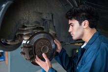 Mechanic Examining Car Brake