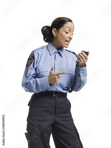 Fototapeta angry policewoman on the radio