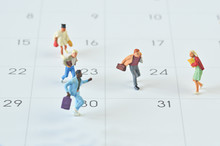 Miniature People Running On Calendar Background
