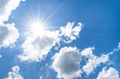 Leinwandbild Motiv Looking up at Nice blue sky with sun beam behind big cloud