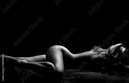 Photo  Black and white nude female portrait.