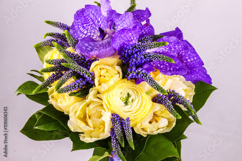 Poster Iris Beautiful bouquet flowers of white Ranunculus, iris purple iris