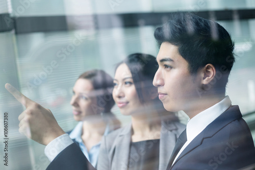 Fotografie, Tablou  Business team looking out of window