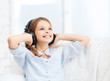 smiling girl with headphones listening to music