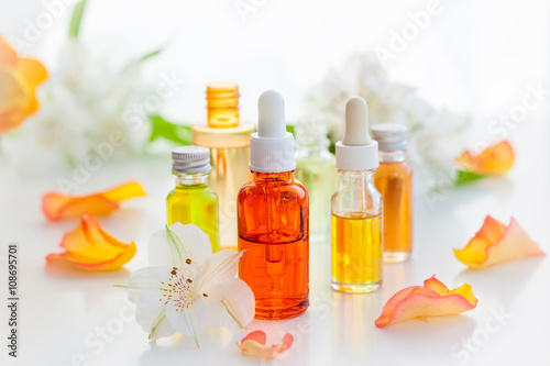 Fotografie, Obraz  Bottles of essential aromatic oils
