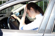 women driving tired pain