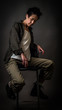 Androgynous character on a gray background. Man or woman. Military style. Very sharp.