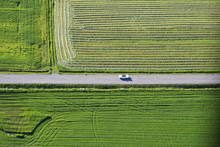 Aerial View Of Car On Road By Fields