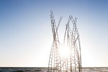 Art  Metallic White Installation At Seaside In Ladder Shapes