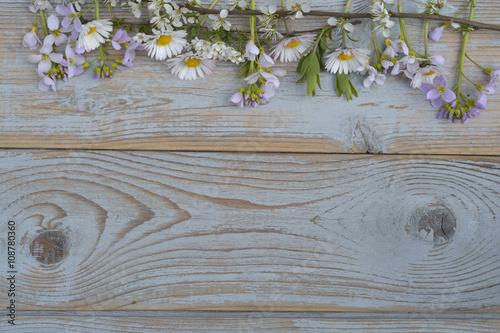 Bunch of fieldflowers,daisies, buttercups, Pentecostal flowers, dandelions  in a Poster