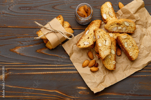 Fotografija Italian cantuccini cookie with almond filling on wooden background
