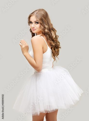 Fotografie, Obraz  Beautiful blonde   girl wearing white  tutu skirt