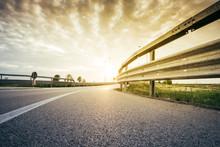 Road And Guard-rail At The Sun...