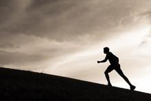 Male Runner Running Up Hill.