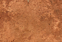 Dry Red Soil And Small Rock In Thailand.