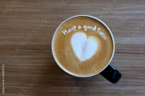Foto op Plexiglas Chocolade Cup of cappuccino art coffee with text have a good time and shap