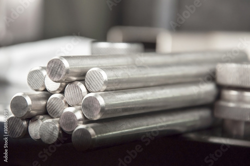 Fotografie, Obraz  stainless steel rods on a welding table