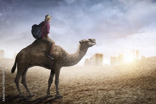 Image of traveler riding camel Fototapete