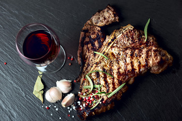 Fototapeta Do steakhouse Steak with spices and glass of red wine