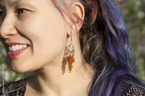 Fotografie, Obraz  Smiling woman with earrings