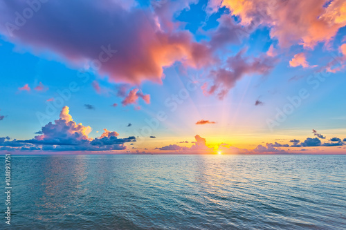 Poster Ocean Colorful sunrise over ocean on Maldives