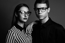 Fashion Models Couple Wearing Sunglasses. Sexy Woman And Handsom