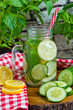 Water with lemon, mint and cucumber on wooden background. Water Detox.