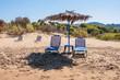 Sunbeds and straw umbrella on Banana beach